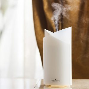 essential oil diffusing from a white diffuser