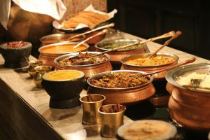 a large buffet of Indian food