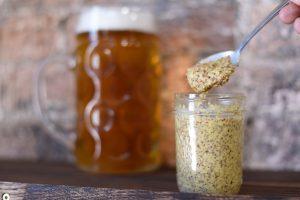 a clear, small mason jar of homemade mustard